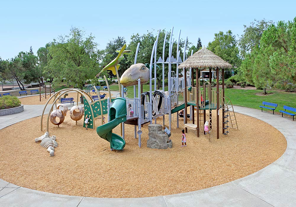 kids playing on dinosaur themed playground