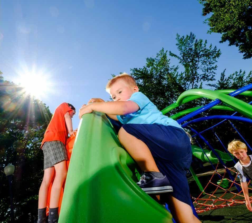 little boy climbing on playground