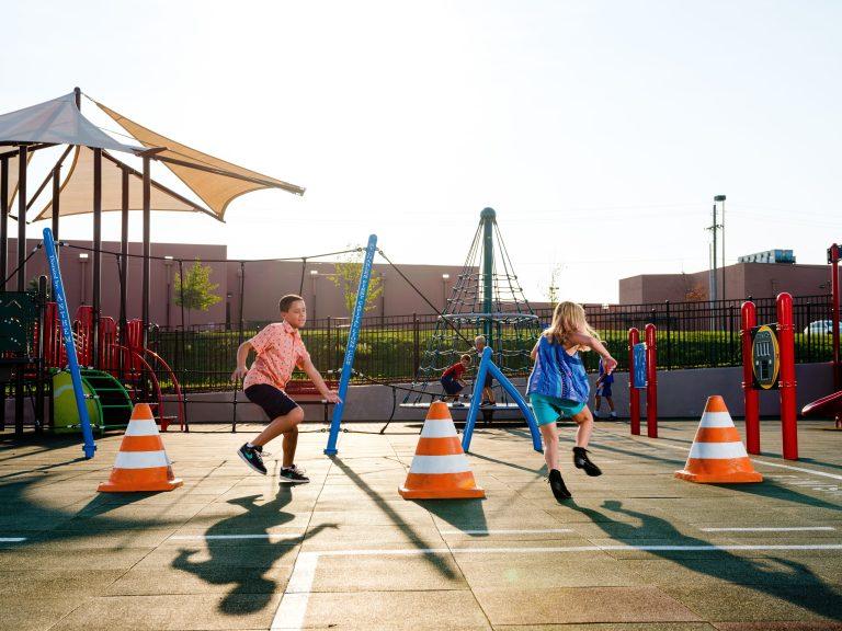 Children running at community park