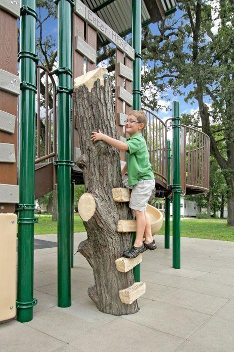 Boy climbing on tree playground equipment