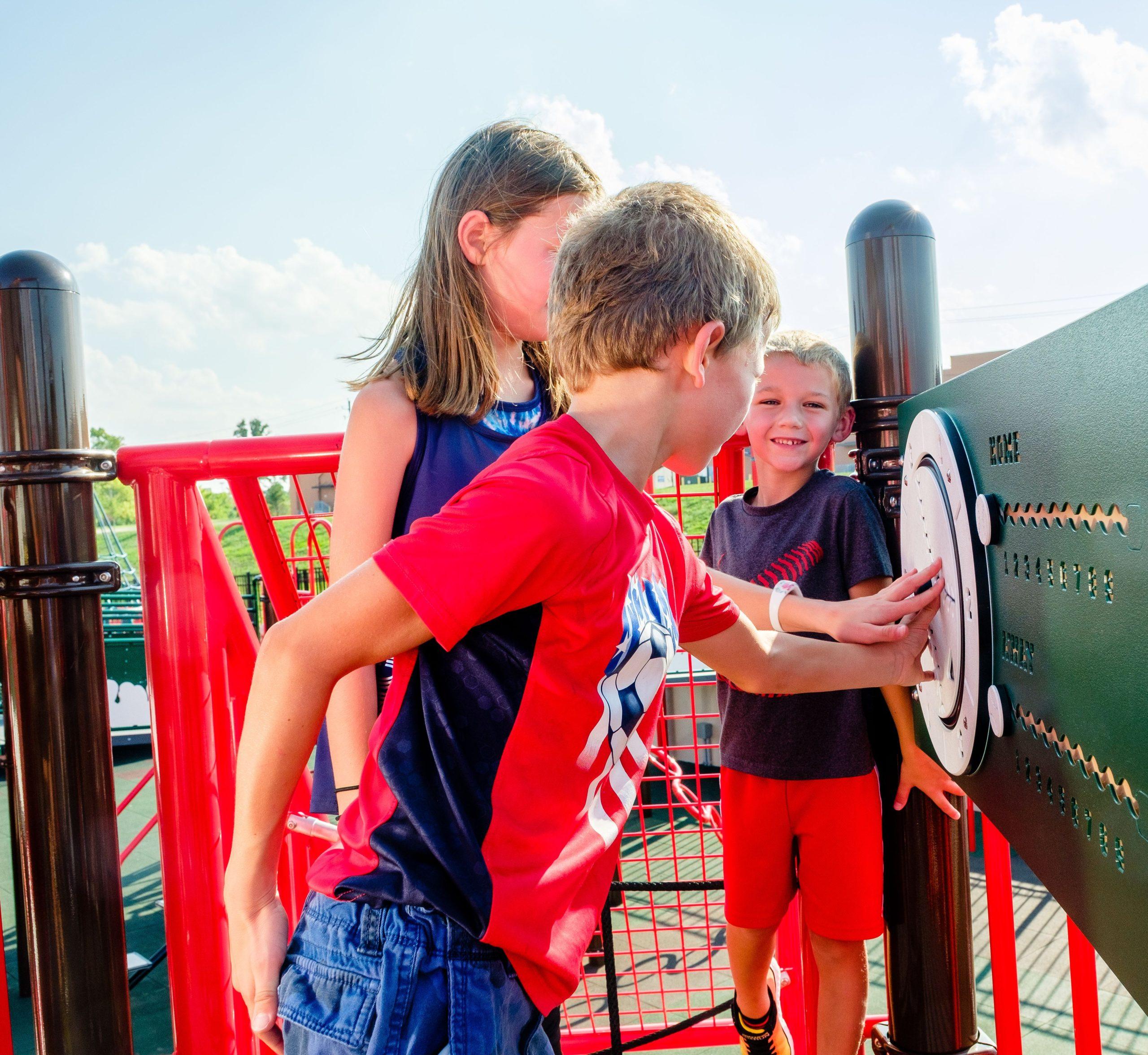 Children playing on Jake Field of Dream playground panels