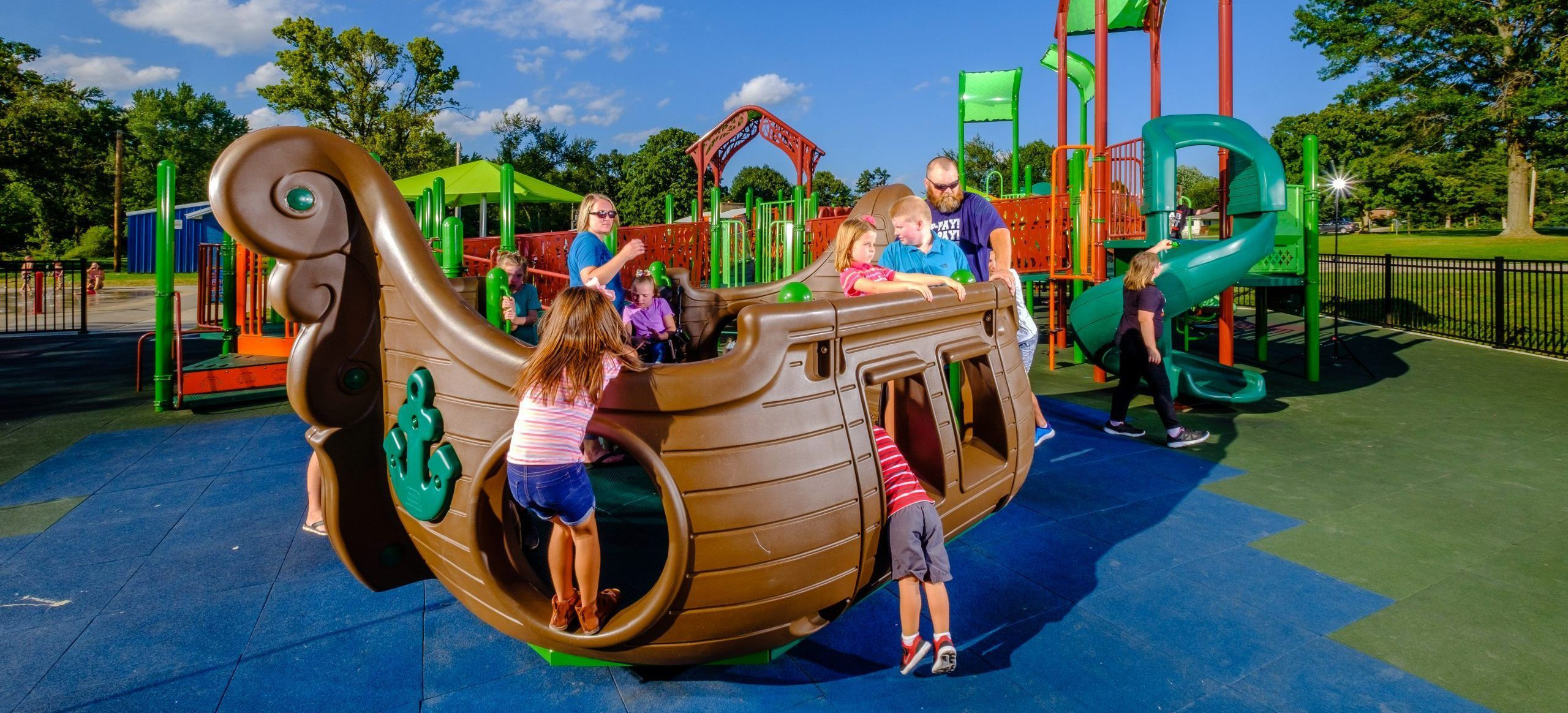Inclusive boat playground structure