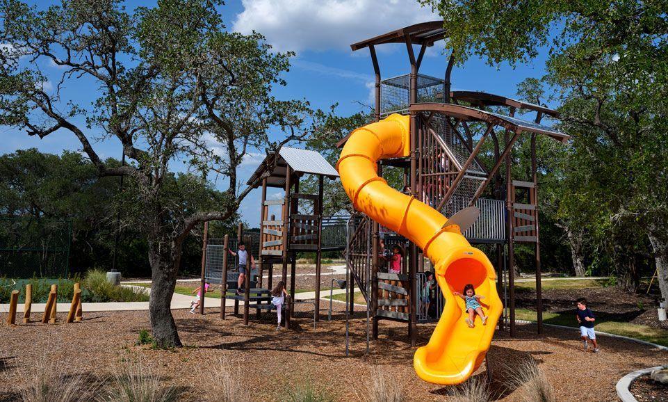 playground with large orange tube slide