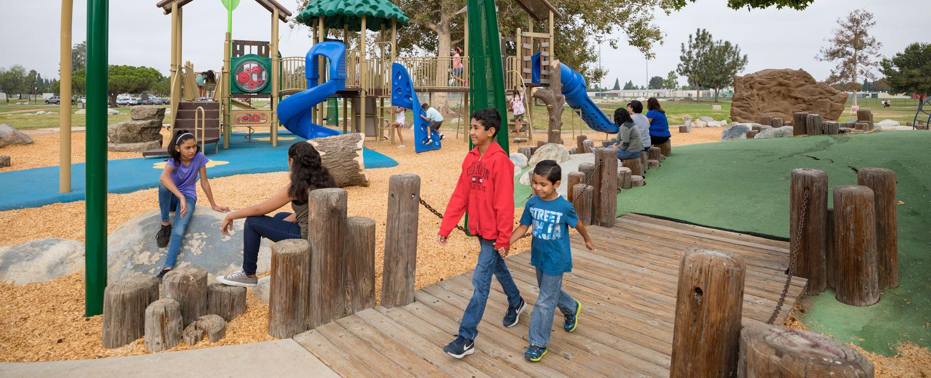 Boys walking through playground equipment
