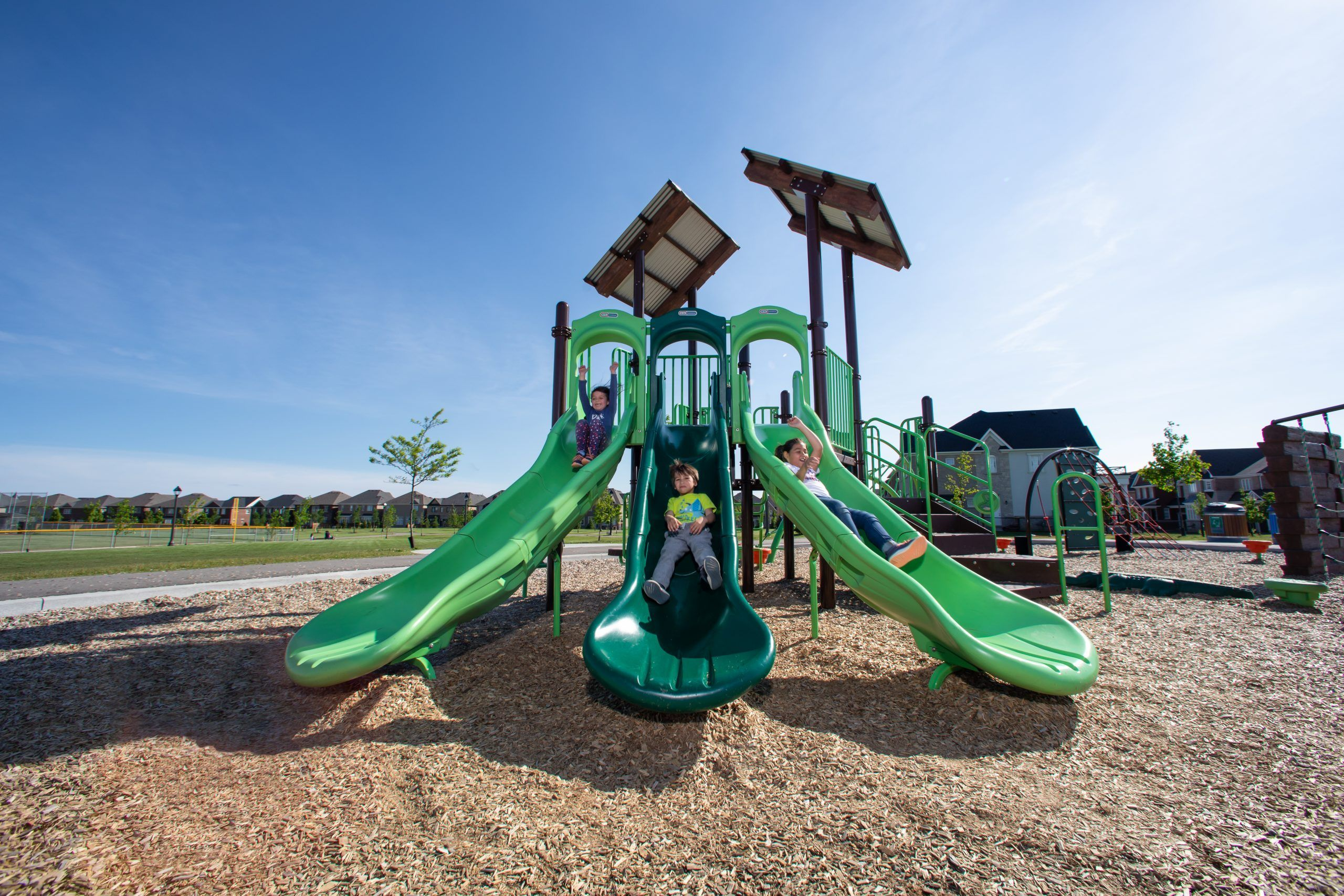 Playground slides with roofs