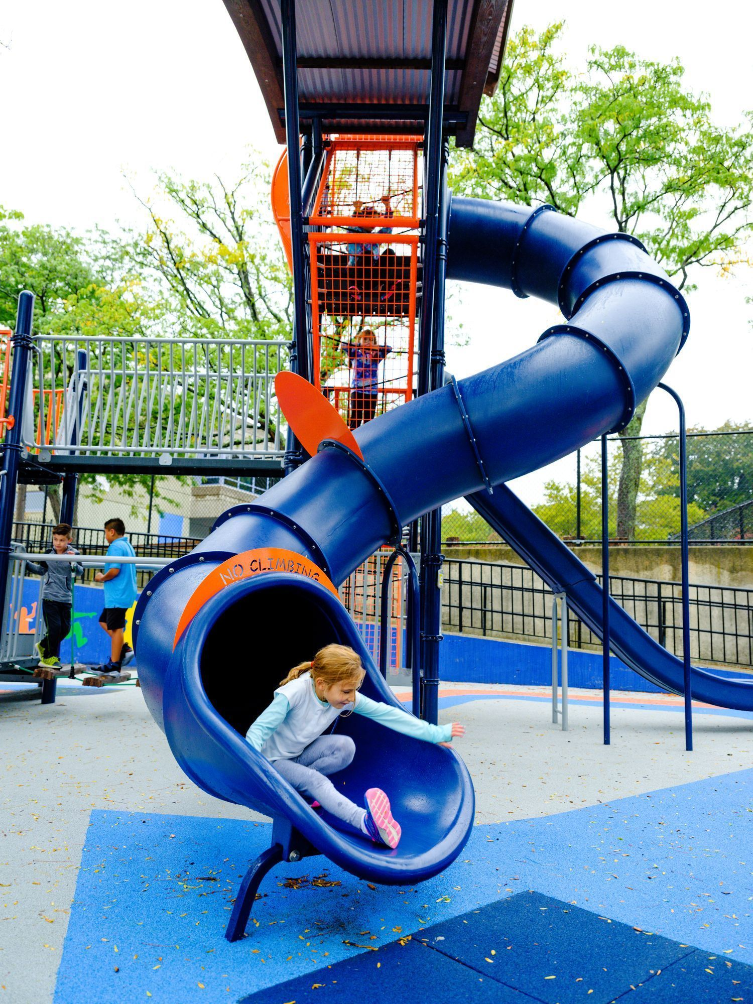 Blue curved playground slide at Winter Hill School