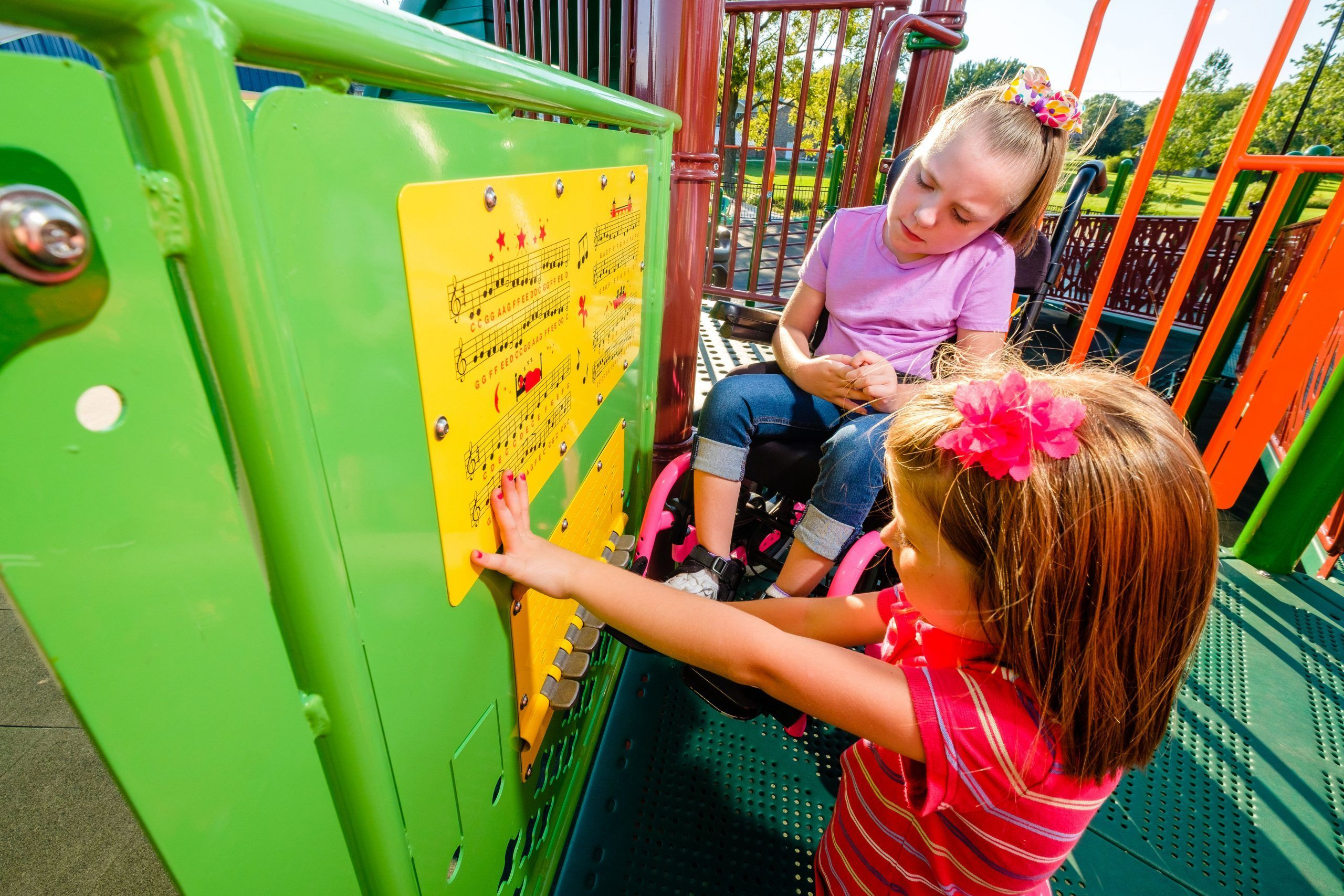 two kids playing with playground piano