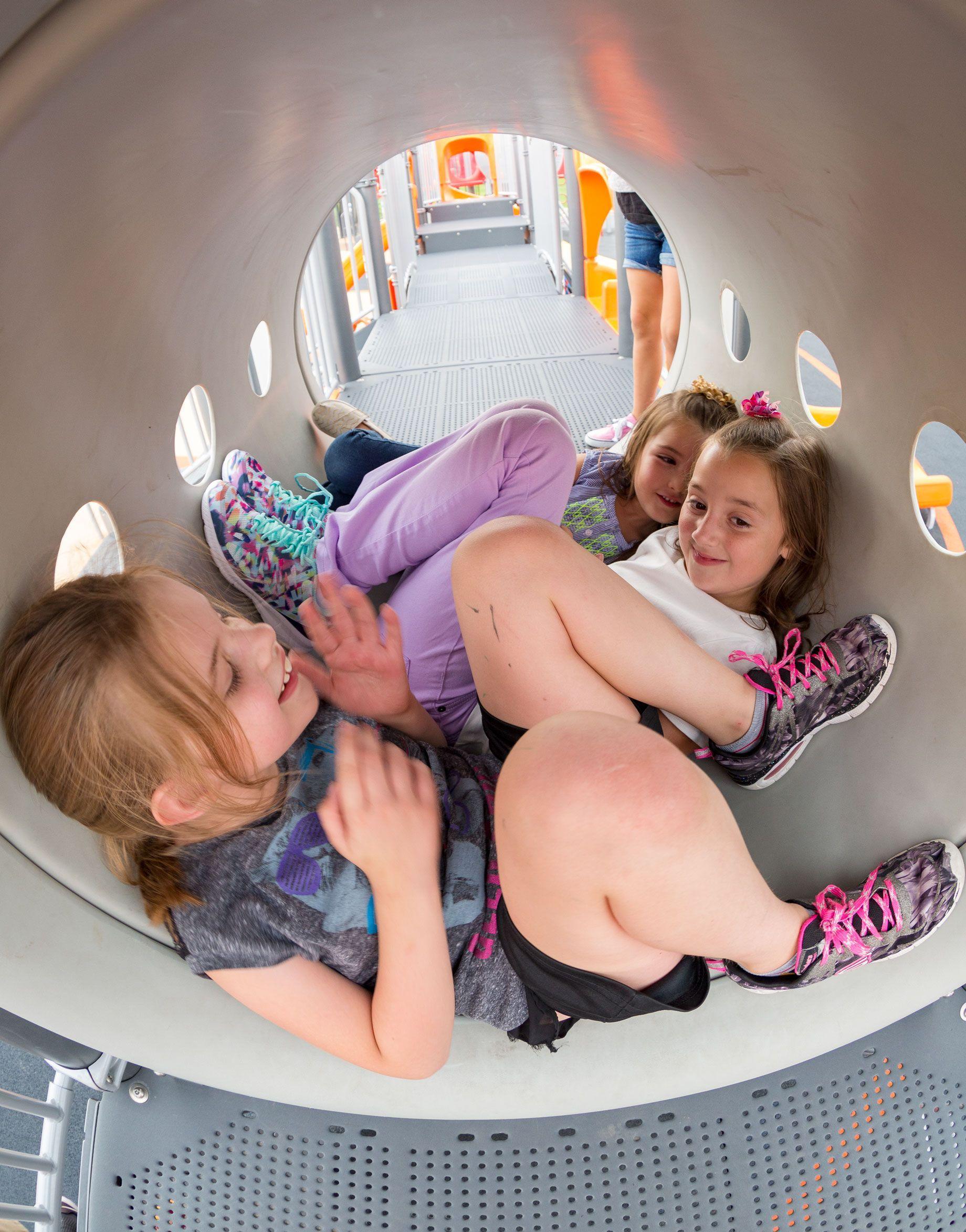 Girls in playground tunnel