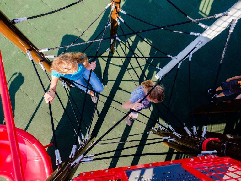 Girls playing on spiderweb