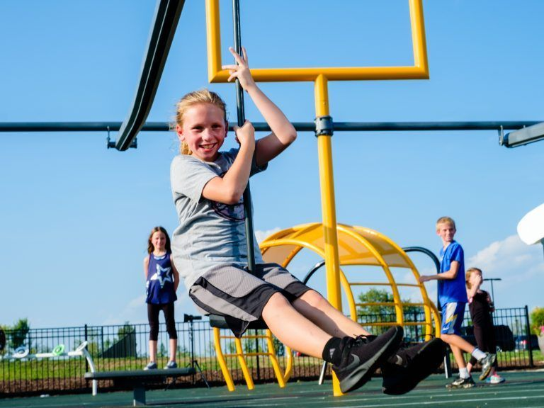 girl on playground swing