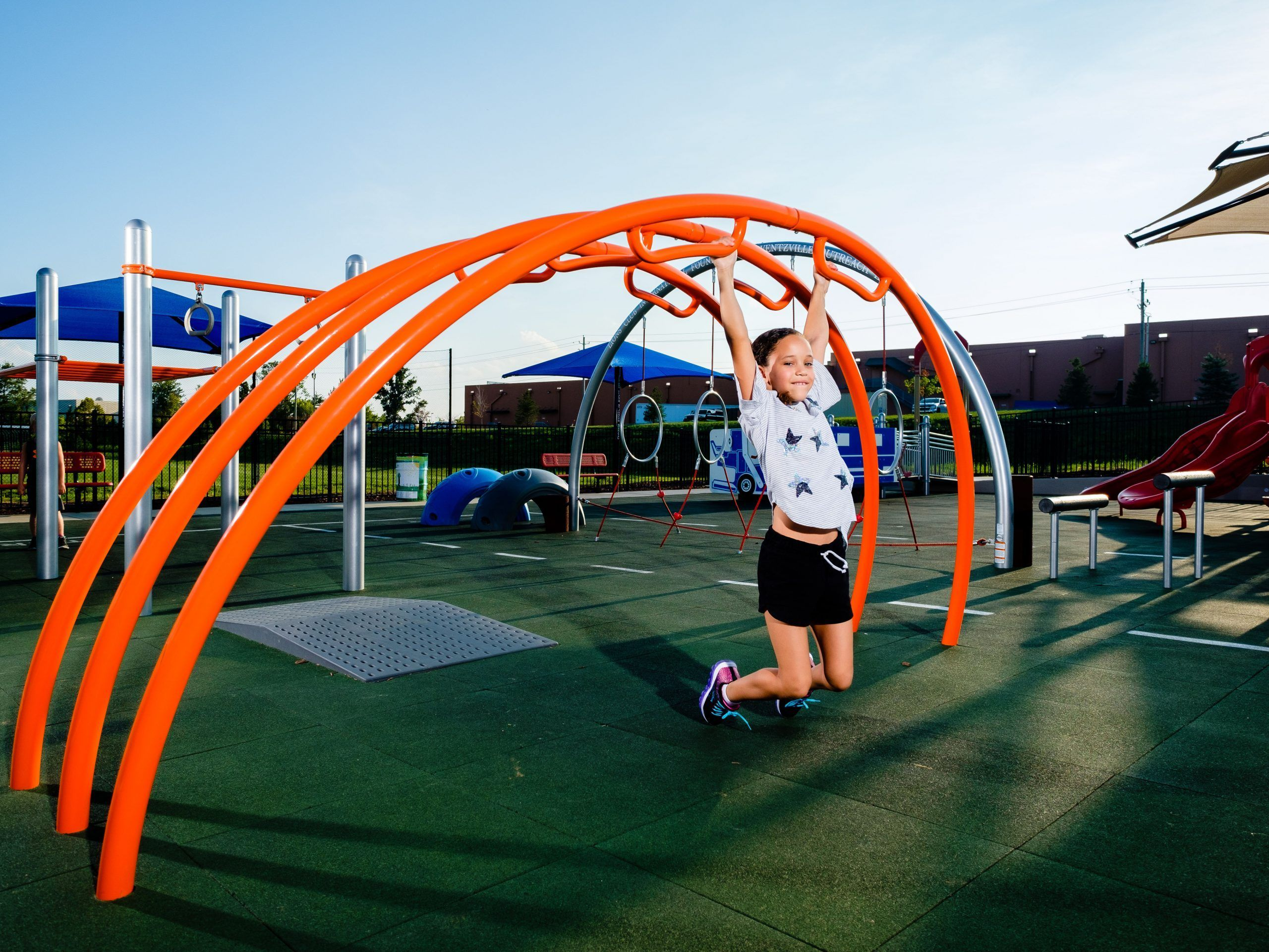 girl hanging on playground