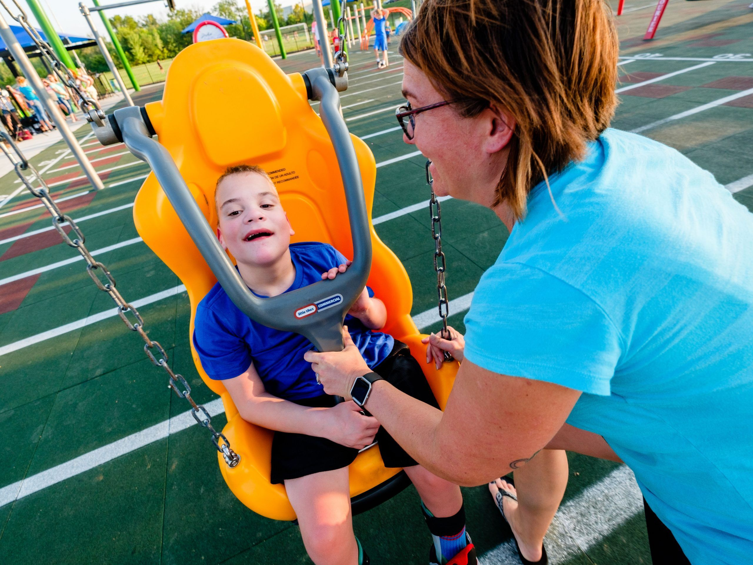 Boy in inclusive swing seat