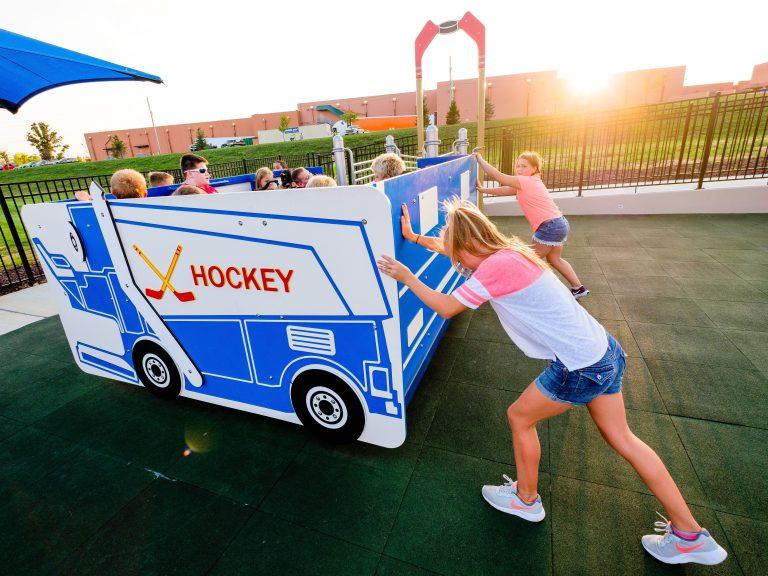 kids in hockey bus