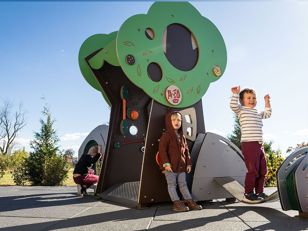 kids playing on playground tree
