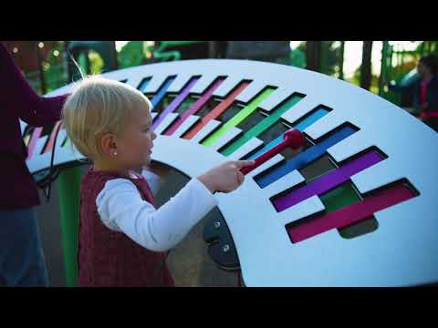 Little girl playing on playground concerto vibraphone