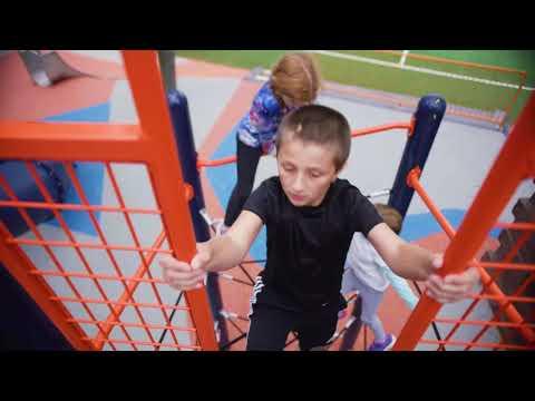 Kids playing on orange jungle gym