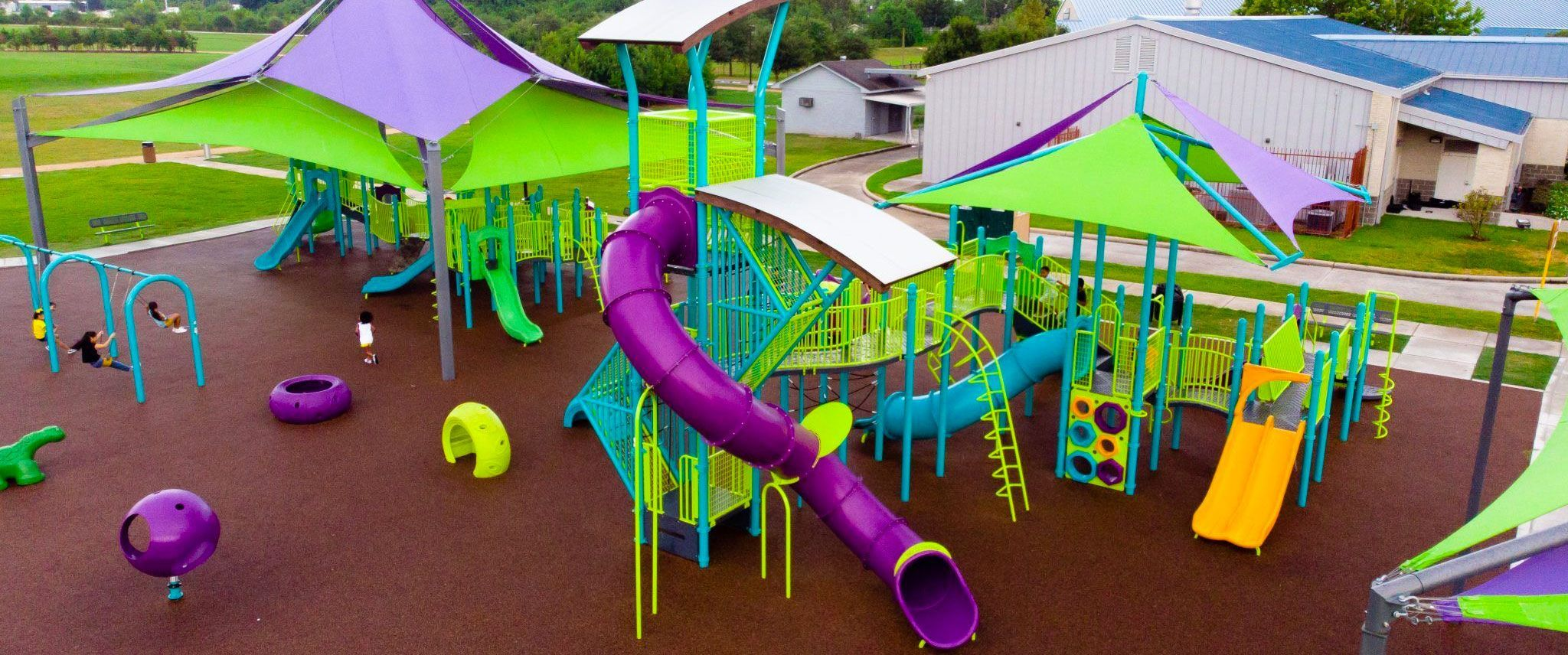 Green and purple playground structures
