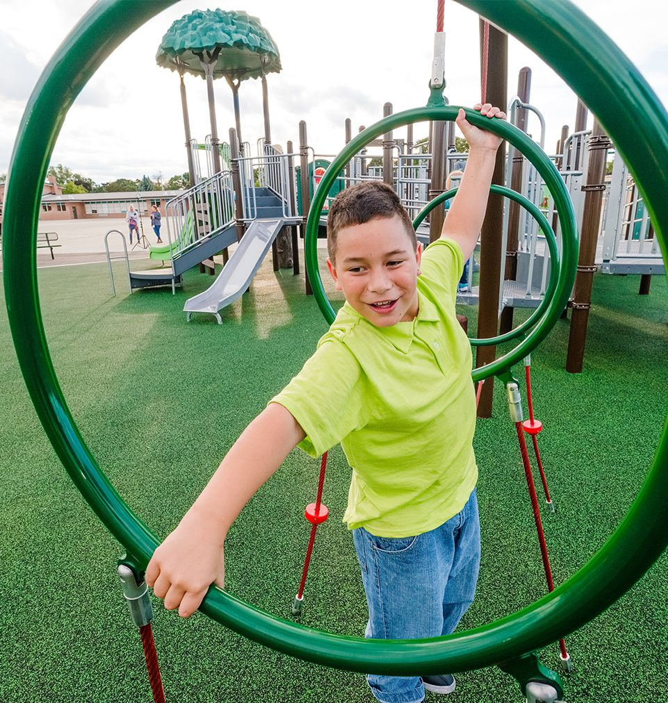 Boy playing on rings at playground