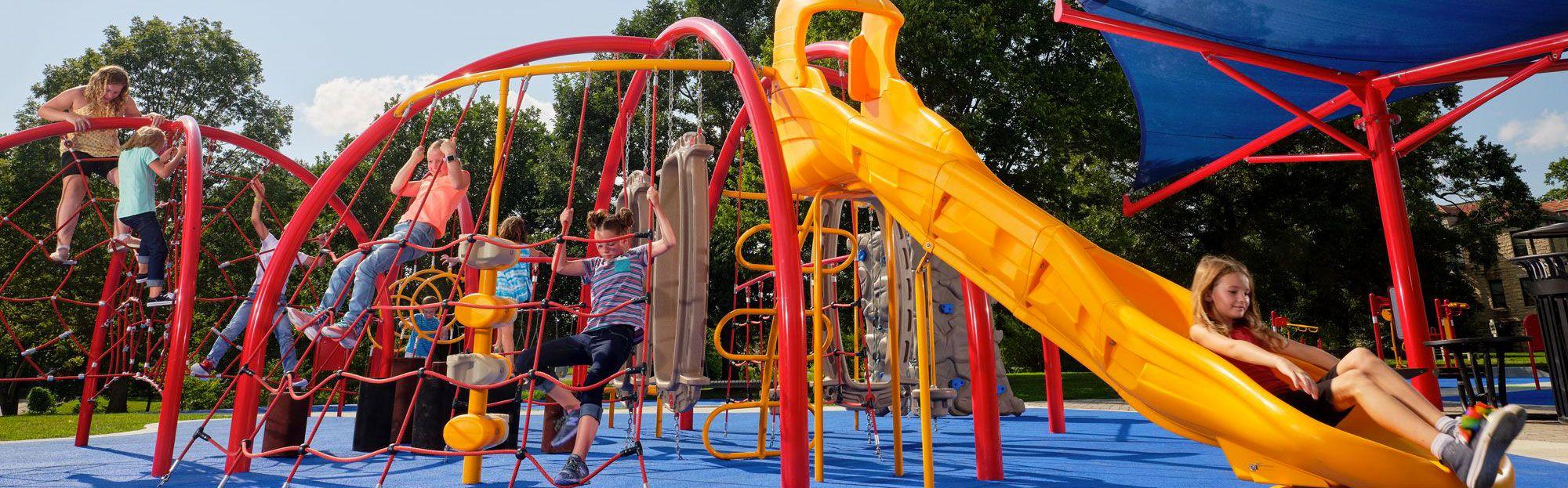 Kids playing on playground Janet Majeras Park