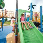 Girls going down slide at Hickory Lane Park