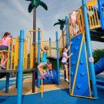 Kids climbing on jungle gym at Hickory Lane Park