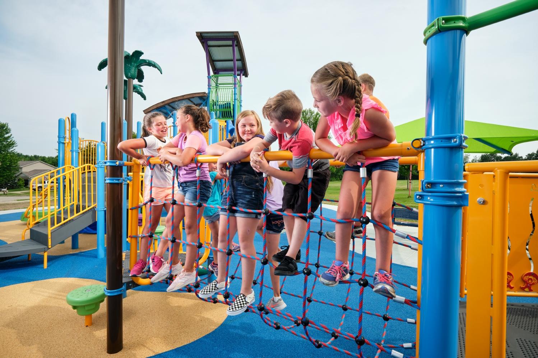 Kids playing on rope bridge at Hickory Lane Park