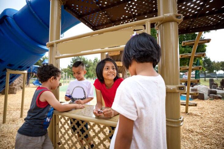 Children playing in playground fort