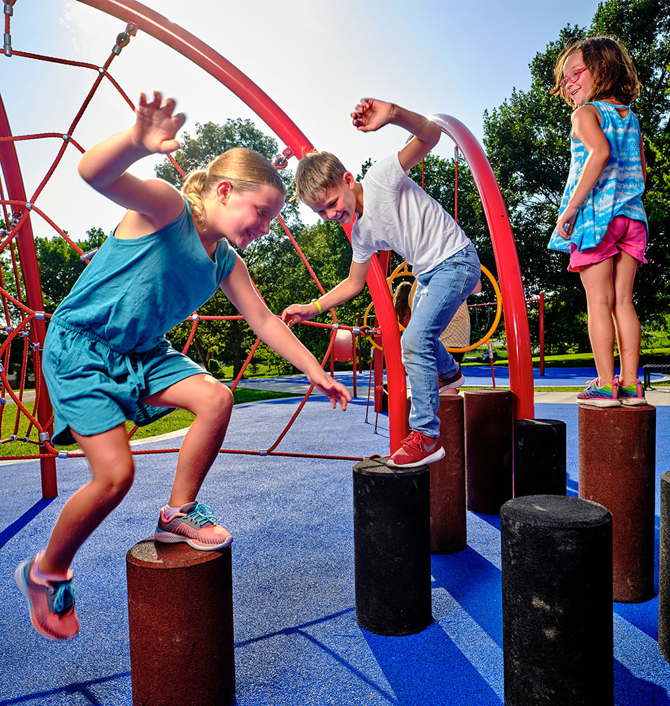 children balancing at the park